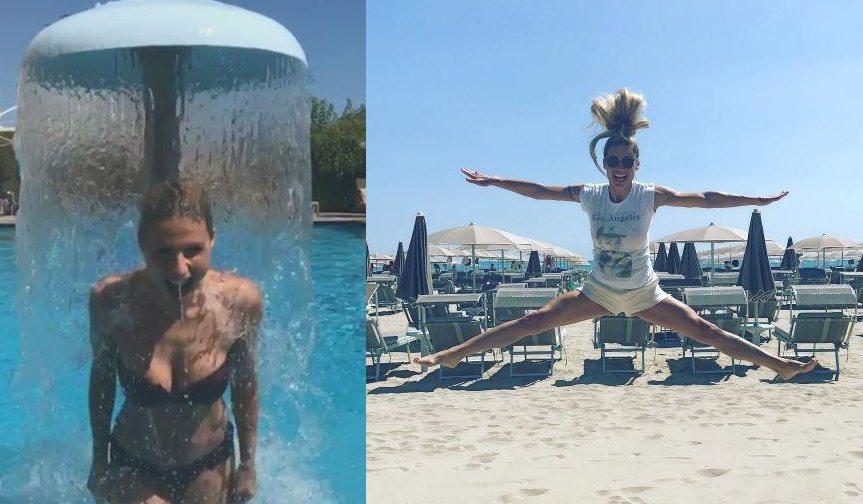 Michelle Hunziker: salti in spiaggia, doccia fredda e giochi sul bagnasciuga
